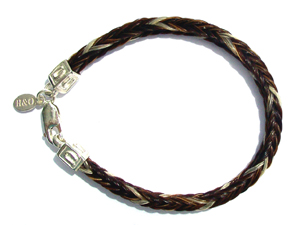 Ozzie 01: Square horsehair braid with sterling silver horseshoe ends and tag. Cost: €130.